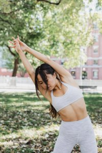 young-woman-stretching-in-a-park_4460x4460